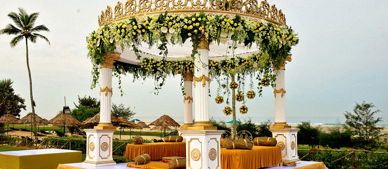 Wedding Ceremony flower decoration on the beach by Kiyoh Wedding Planner. Outdoor wedding venues in chennai