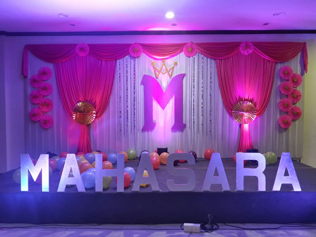 stage decorated with balloons for a birthday party by kiyoh event planner