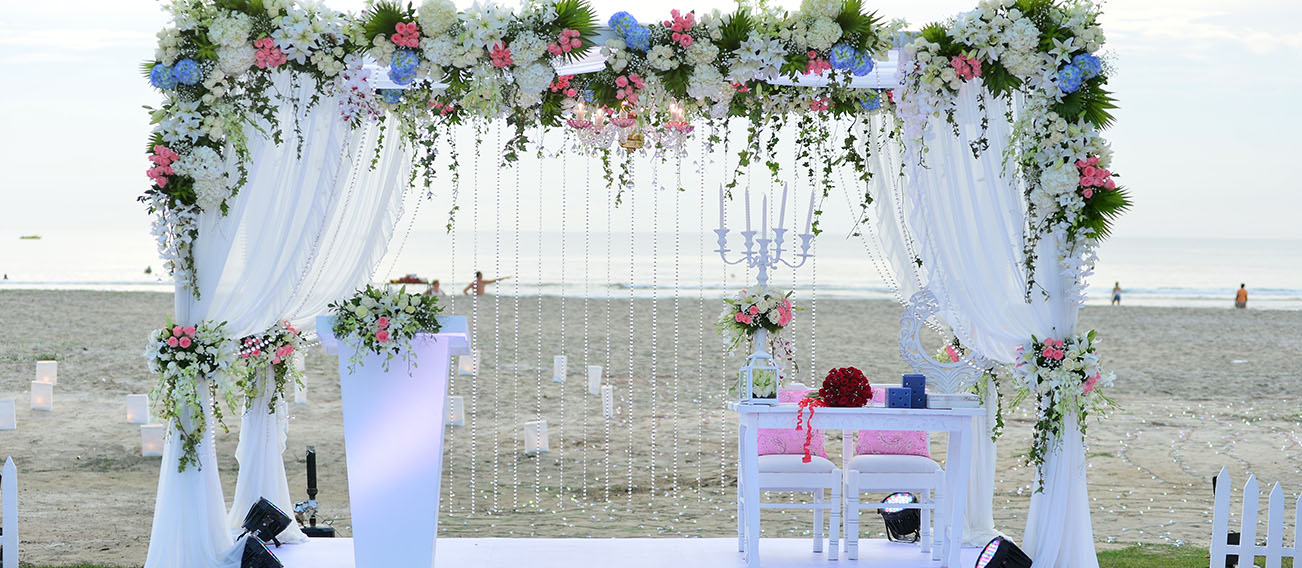 Luxury Wedding arch on the beach.Flower decoration by Kiyoh Wedding Planner